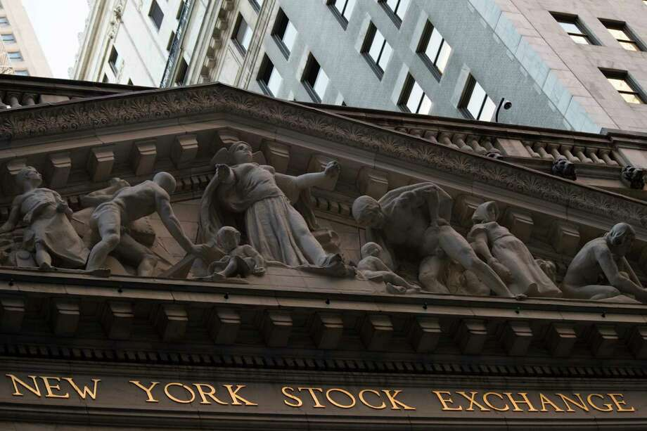 FILE - This Tuesday, Oct. 25, 2016, file photo shows the New York Stock Exchange at sunset, in lower Manhattan. Global stocks fell Monday, Nov. 13, 2017, as investors became more cautious after several market indexes hit record highs in the past week. (AP Photo/Mary Altaffer, File) Photo: Mary Altaffer, STF / Copyright 2016 The Associated Press. All rights reserved.