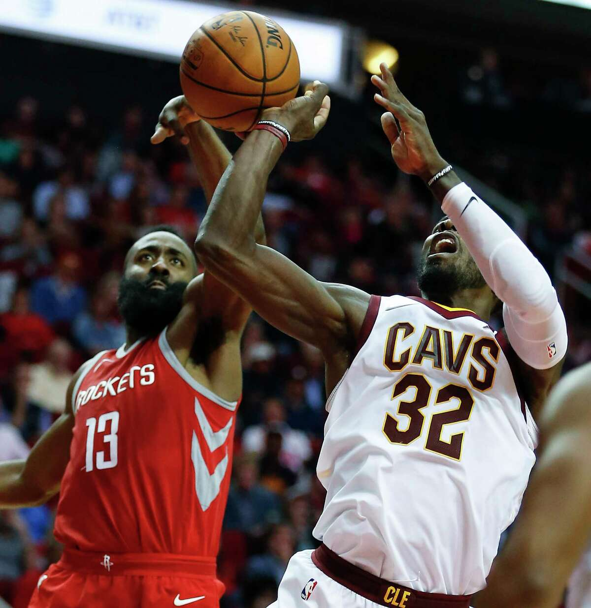 Guard James Harden, left, has become used to guarding anyone on the floor, including Cavs forward LeBron James.