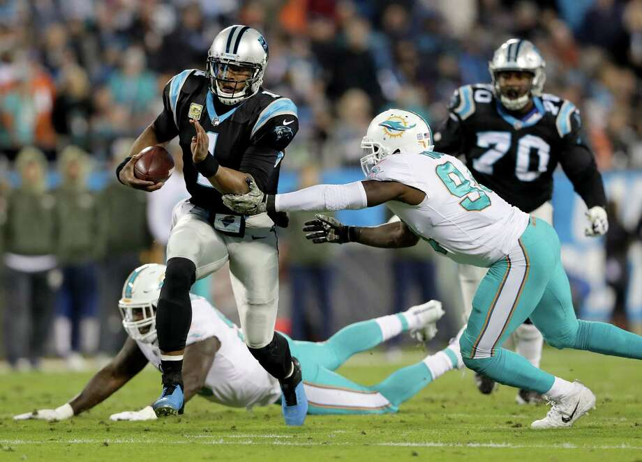 CHARLOTTE, NC - NOVEMBER 13:  Cam Newton #1 of the Carolina Panthers runs with the ball against the Miami Dolphins during their game at Bank of America Stadium on November 13, 2017 in Charlotte, North Carolina.  (Photo by Streeter Lecka/Getty Images) ORG XMIT: 700070742 Photo: Streeter Lecka / 2017 Getty Images
