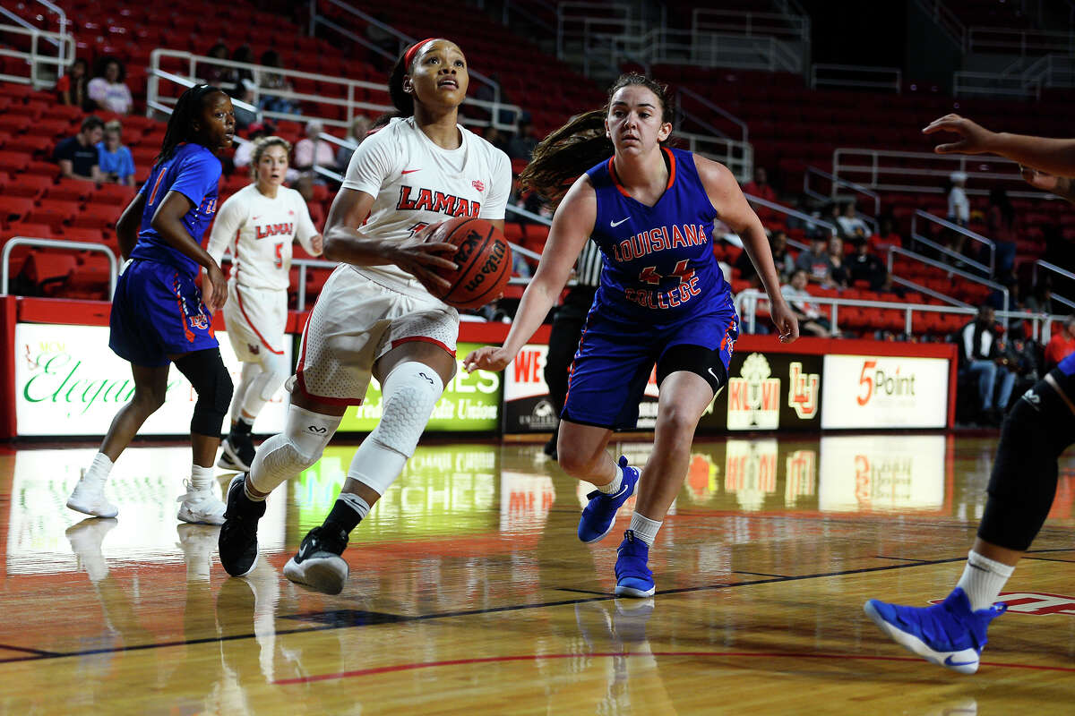 Lamar's Chastadie Barrs drives the lane against Louisiana College during the women's basketball team's season opener at the Montagne Center on Monday night. The Lady Cardinals went undefeated at home last season. Photo taken Monday 11/13/17 Ryan Pelham/The Enterprise