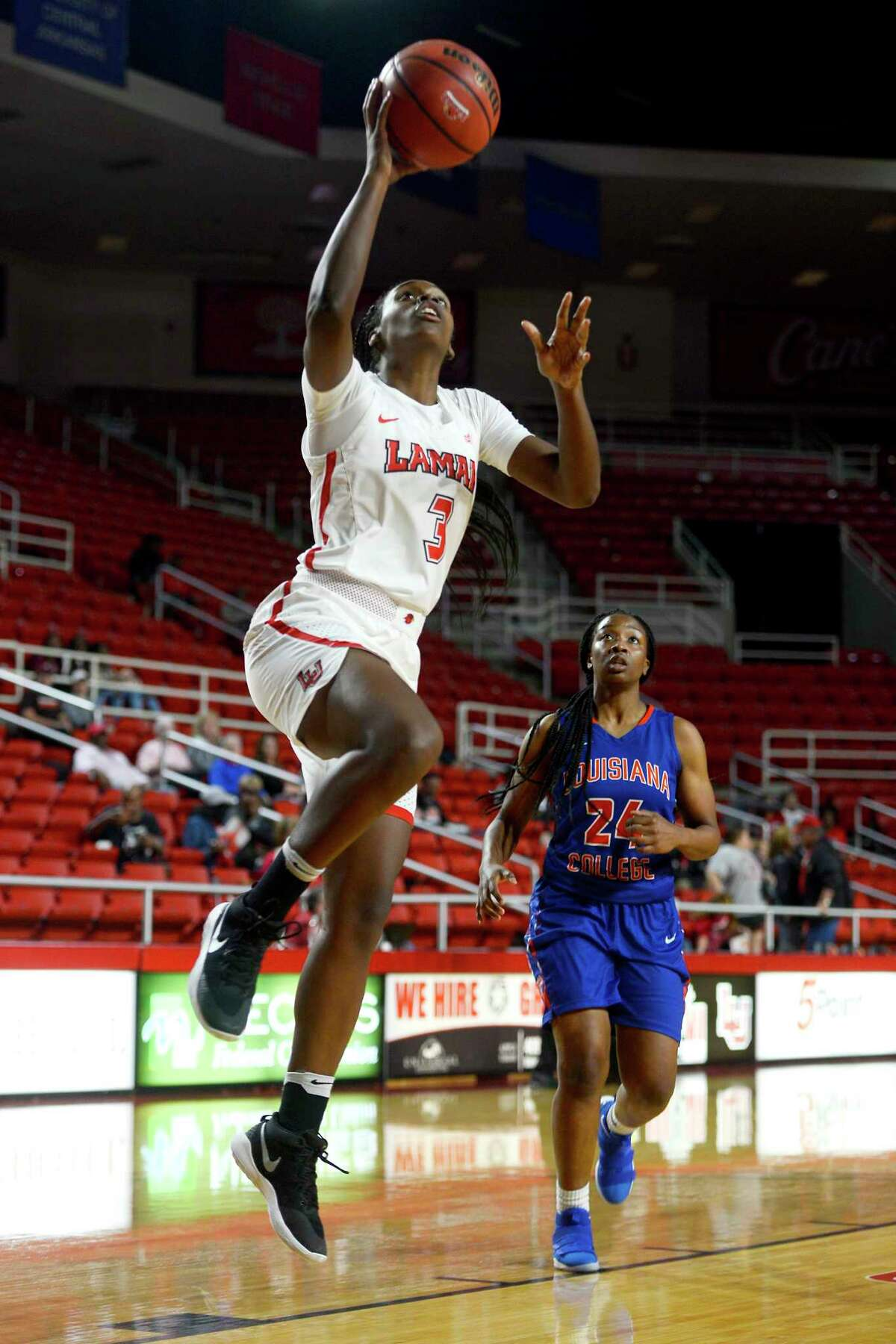 Lamar's Kyla Green takes a layup during the women's basketball team's season opener against Louisiana College at the Montagne Center on Monday night. The Lady Cardinals went undefeated at home last season. Photo taken Monday 11/13/17 Ryan Pelham/The Enterprise