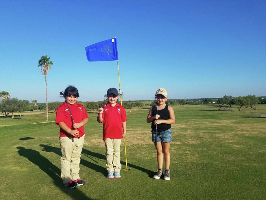 Blessed Sacrament hosted a tournament Nov. 5 at the Casa Blanca Golf Course. Pictured from left are Carolina Gonzalez, Regina Reyes and Maya Palacios who all placed in the Top 3 in the 6-7 year old category. Photo: Courtesy Photo