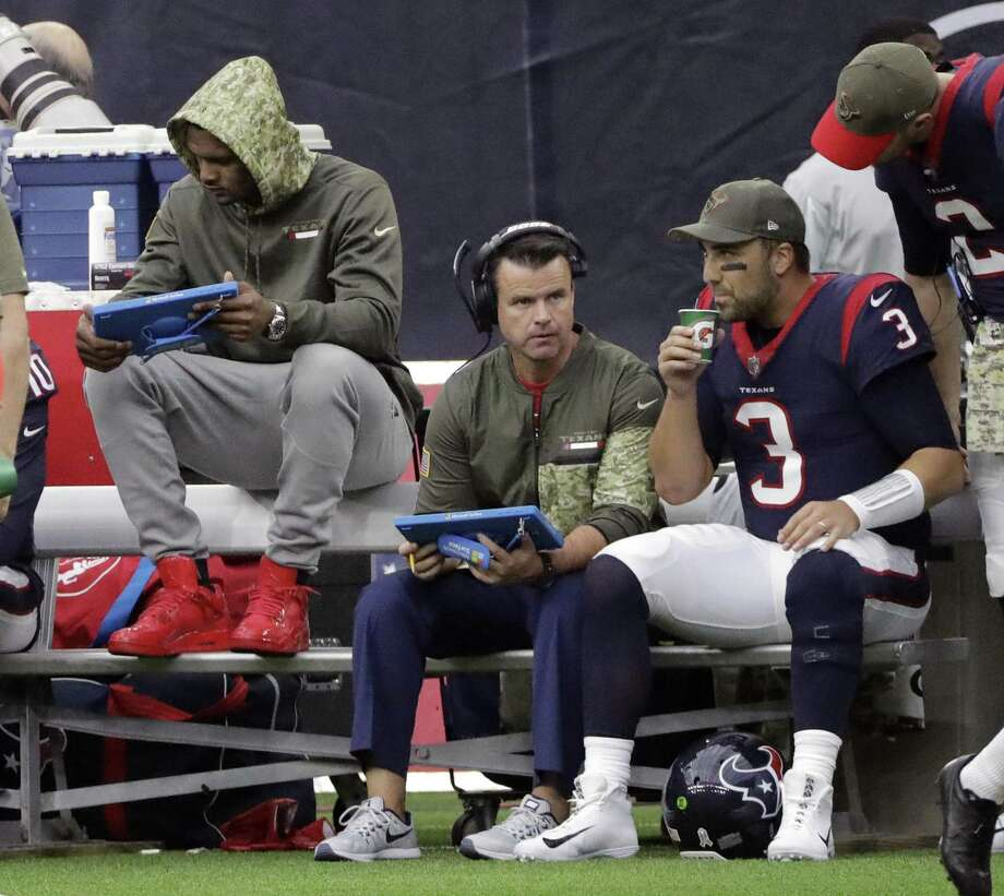 Deshaun Watson, left, is out for the rest of the season with a torn ACL. The Texans, who had the No. 1 offense in the league under Watson, have lost two straight with Tom Savage, right, under center scoring a combined 21 points in that span. Photo: David J. Phillip /Associated Press / Copyright 2017 The Associated Press. All rights reserved.