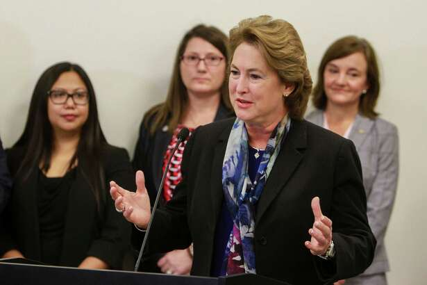 District Attorney Kim Ogg speaking during a news conference discussing $4 million in grants from the Texas Governor's Office to assist victims of violent crime and combat sex traffickers.