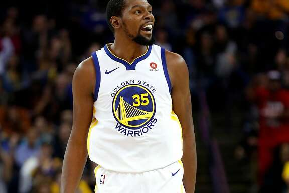 Golden State Warriors' Kevin Durant reacts to a 2nd quarter basket he made against Orlando Magic during NBA game at Oracle Arena in Oakland, Calif., on Monday, November 13, 2017.