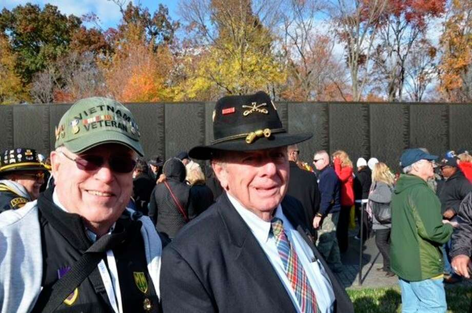 Fred Honerkamp, left, stands withJoe Galloway, author of 'We were Soldiers Once,'at the Vietnam Memorial Wall. (Photo provided)