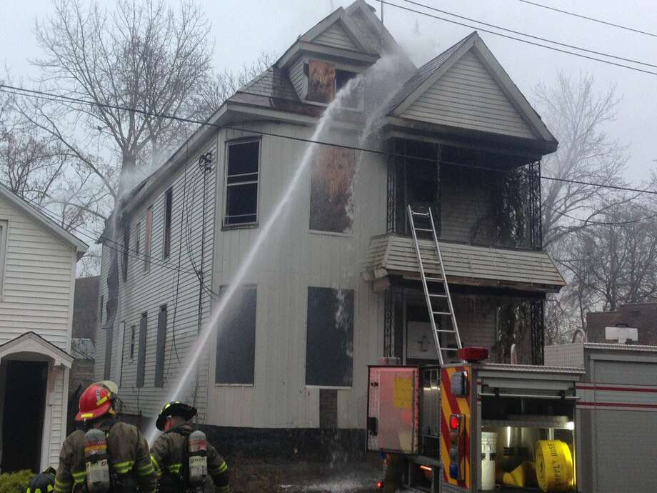 Schenectady firefighters pour water on a raging fire that gutted a Schenectady Street home on Tuesday, Nov. 14, 2017. The smoke rising from the morning blaze at 525 Schenectady St., could be seen for miles around. Photo: Paul Nelson/Times Union