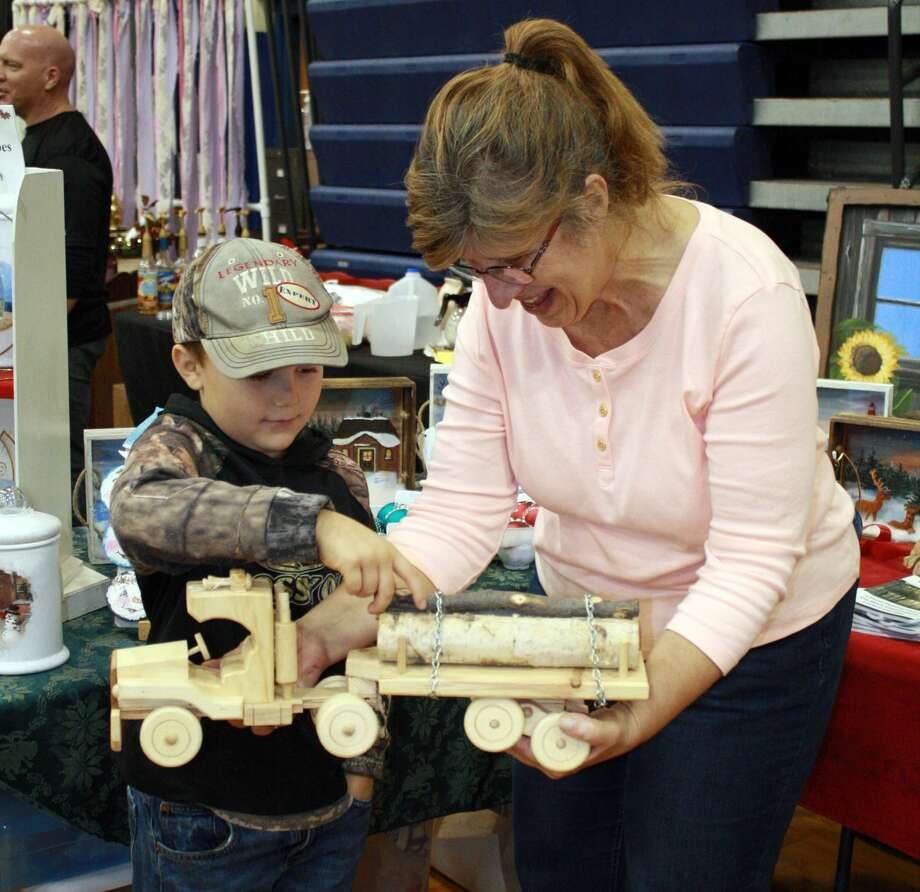 Crafters and vendors from all over the Upper Thumb filled the gymnasium at Bad Axe Middle School on Saturday for the ninth annual Mistletoe Market. Shoppers took advantage of the event to get a jumpstart on this year's holiday shopping season. Photo: Rich Harp/For The Tribune