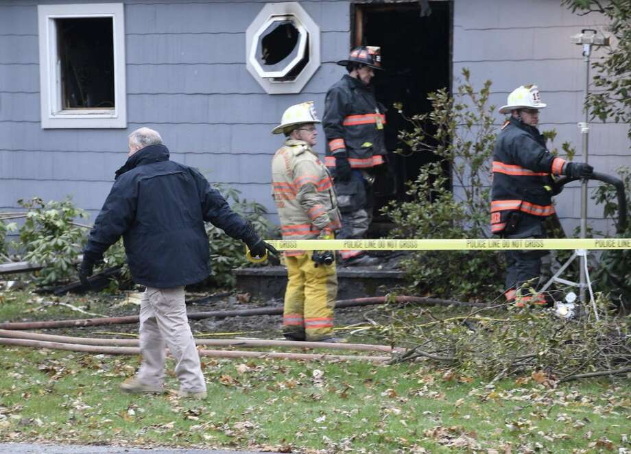Firefighters work at the scene of a fire that damaged a home Tuesday morning, Nov. 14, 2017, in Cambridge. Photo: Skip Dickstein / Times Union