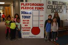 Church Hill Elementary Students stand next to their Playground Pledge Fund Thermometer. Front row from left to right Sawyer Snyder, Takara Coleman, Yolali Cruz and Sloane James. Back row: Myla Perez, Lilly Perez, Tristan Salceudo and Kendadee Black.