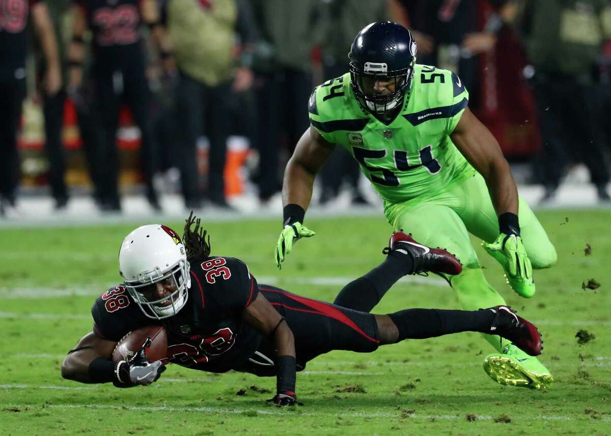 Former Cardinals running back Andre Ellington (38) has been reunited with cousin Bruce Ellington, a wide receiver with the Texans.