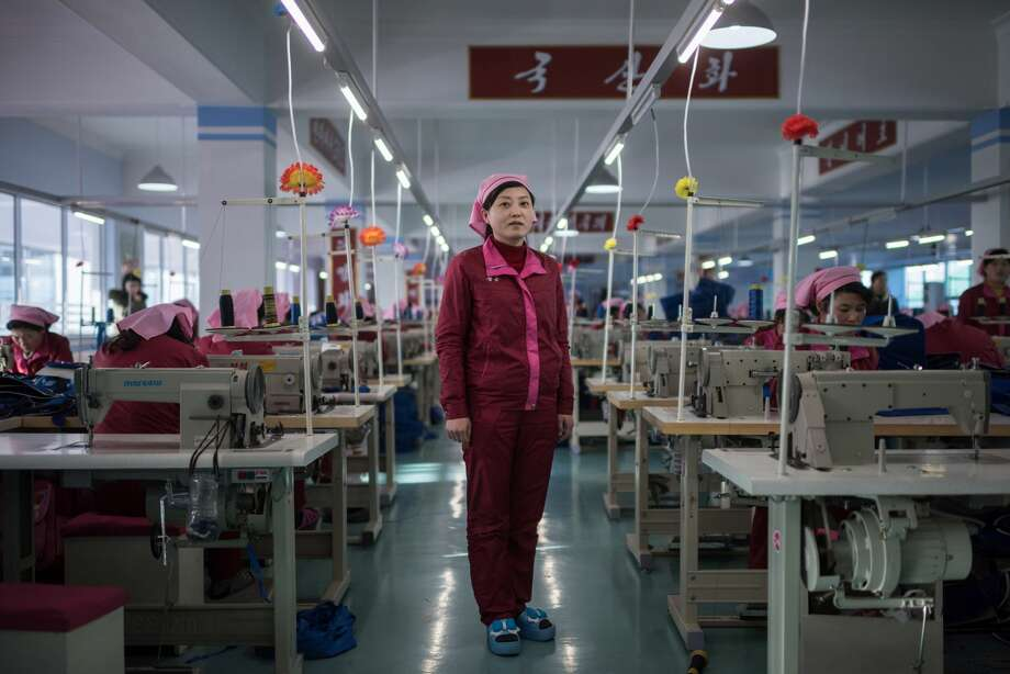 In this photo taken on February 18, 2017, Pak Song Hyang, 30, stands between sewing machines at a facility described to AFP as the 'Pyongyang Bag Factory' in Pyongyang. / AFP / Ed JONES        (Photo credit should read ED JONES/AFP/Getty Images) Photo: ED JONES/AFP/Getty Images