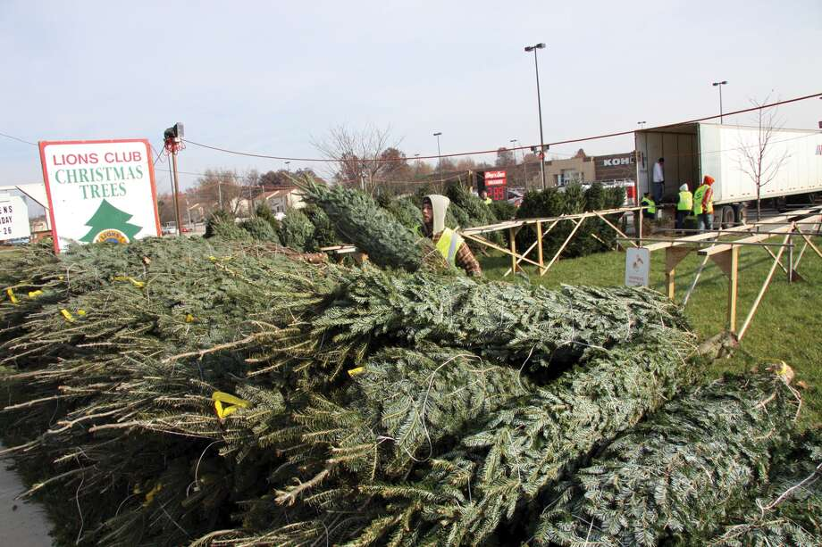 Trees are delivered to the Edwardsville Lions Club lot prior to a previous Christmas. The lot will again be located on Troy Road, in front of Shop 'n Save. Photo: Intelligencer Photo