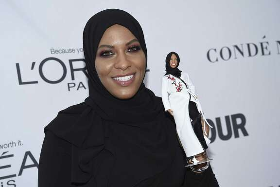 Ibtihaj Muhammad holds a Barbie doll in her likeness at the 2017 Glamour Women of the Year Awards at Kings Theatre on Monday in New York. Mattel Inc. said the doll will be available online next fall.
