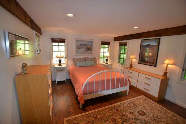 Killington, Vt.  Low Pressure Lodge. Price: from $650 per night. Adirondack-inspired home suitable for an extended family or two families in separate wings joined by two family rooms. Sleeps 12: six bedrooms, 11 beds, 4.5 baths. Theater, rooftop hot tub.  View full listing on Airbnb.