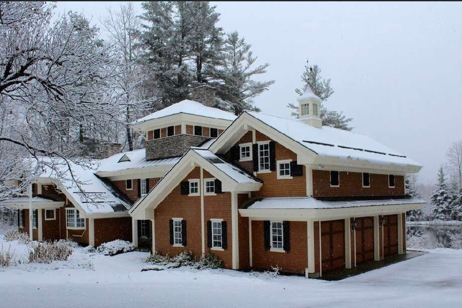 Killington, Vt. Low Pressure Lodge. Price: from $650 per night. Adirondack-inspired home suitable for an extended family or two families in separate wings joined by two family rooms. Sleeps 12: six bedrooms, 11 beds, 4.5 baths. Theater, rooftop hot tub. View full listing on Airbnb. Photo: Airbnb