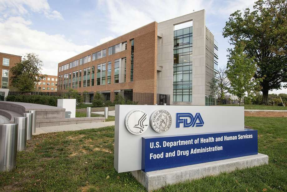 FILE - This Oct. 14, 2015, file photo, shows the U.S. Food & Drug Administration campus in Silver Spring, Md. On Monday, Nov. 13, 2017, the FDA approved the first drug in the United States with a digital ingestion tracking system, in an unprecedented move to ensure that patients with mental illness take the medicine prescribed for them. The drug Abilify MyCite was developed by Otsuka Pharmaceutical Co., Ltd. (AP Photo/Andrew Harnik, File) Photo: Andrew Harnik, Associated Press