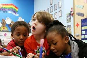 Pre-school students conduct a science experiment at the Goddard School in the Long Meadow Farms location Thursday, Jan. 28, 2016, in Houston. ( Jon Shapley / Houston Chronicle )