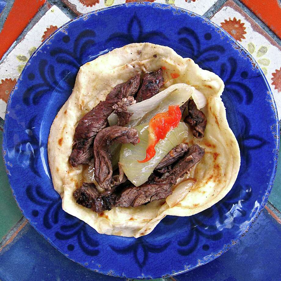 Beef fajita taco with onions and peppers on a handmade flour tortilla from La Margarita Mexican Restaurant & Oyster Bar. Photo: Mike Sutter /San Antonio Express-News