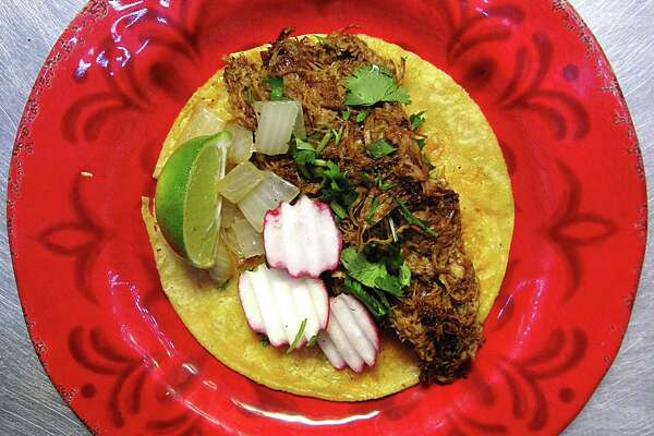 Taco of the Week: Pork birria taco on a corn tortilla with onions, cilantro and radishes from El Bandolero taco truck.