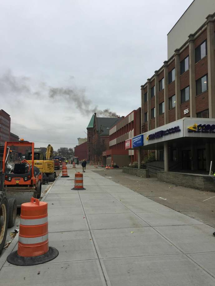 The black cloud seen rising from the roof of the Washington Avenue Armory in Albany Tuesday was not from a fire, a spokesman for the arena said Tuesday. Instead, what billowed from the roof at about 9 a.m. was black soot fromheating, ventilation and air conditioning systems. Photo: Matthew Hamilton / Times Union