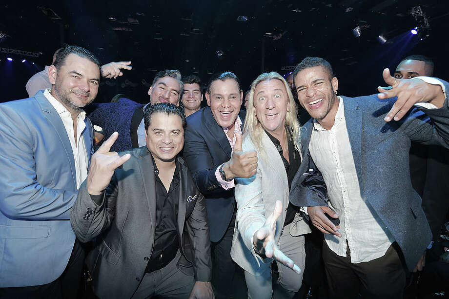 FILE - This 2016 photo shows Sammy Sosa (in the middle with the thumbs-up sign) with decidedly lighter skin than what most sports fans might remember.  In this photos, Sosa attends InList's 2nd anniversary party on November 30, 2016 in Miami, Florida. Photo: Photo By Romain Maurice/Getty Images For InList
