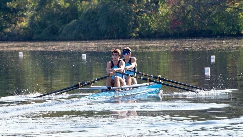 Members of GMS Rowing in New Milford, Jeffrey Schlyer of New Milford, left, and Nico Salazar of Ridgefield, earned gold medals in the men's youth double event at the recent 53rd annual Head of the Charles Regatta. Photo: Courtesy Of Vlad Popov / The News-Times Contributed