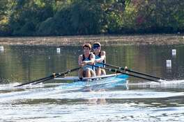 Members of GMS Rowing in New Milford, Jeffrey Schlyer of New Milford, left, and Nico Salazar of Ridgefield, earned gold medals in the men's youth double event at the recent 53rd annual Head of the Charles Regatta.