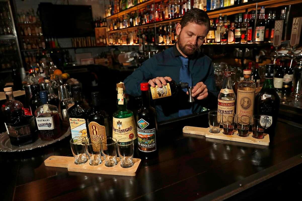 Bar manager Davide Diana prepares flights of Amaro and Fernet at Bar 821 along Divisadero St. on Monday Nov. 13, 2017, in San Francisco , Ca.