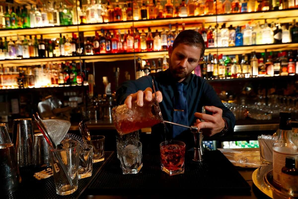 Bar manager Davide Diana prepares a cocktail at Bar 821 along Divisadero St. on Monday Nov. 13, 2017, in San Francisco , Ca.
