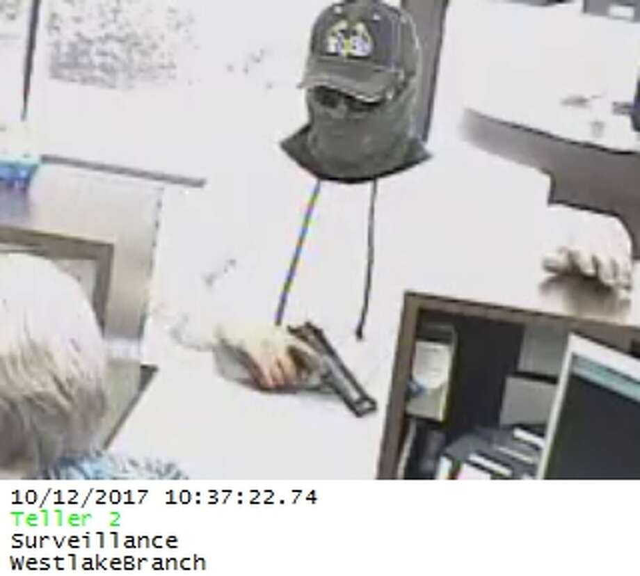Law enforcement officials in Louisiana are seeking the public's help identifying two men who robbed a Westlake bank October 12, 2017. Photos: Westlake Police Department Photo: Westlake Police Department