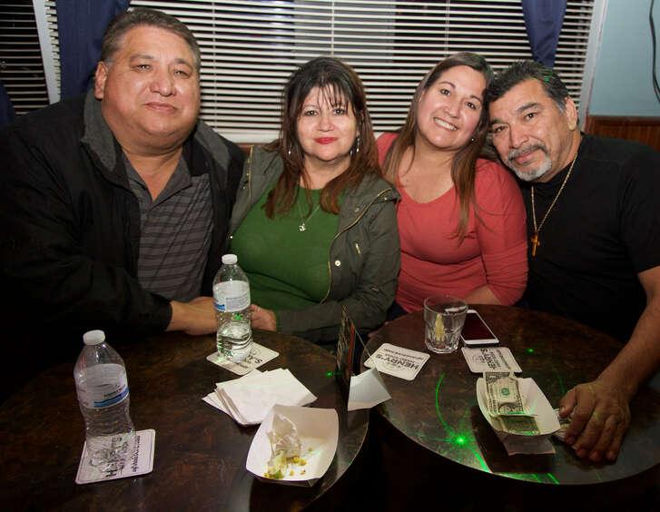 Joe Garcia ,JoAnn Garcia, Patci Lozano, and Rodger Lozano are at Marty's Cocktails.