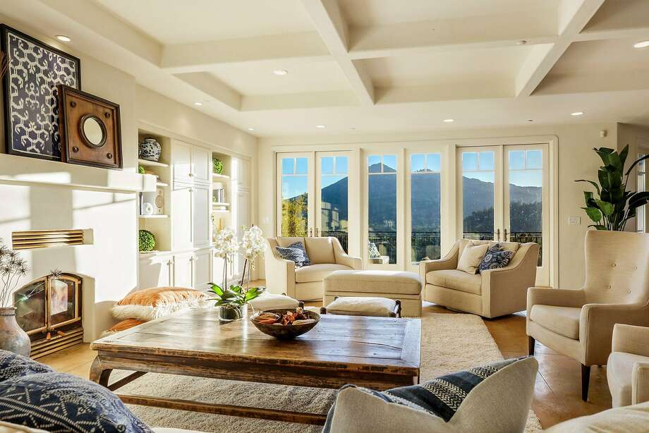 A coffered ceiling at 301 Makin Grade in Kentfield shelters a living room that includes a fireplace and built-ins. Photo: Rob Jordan Photography