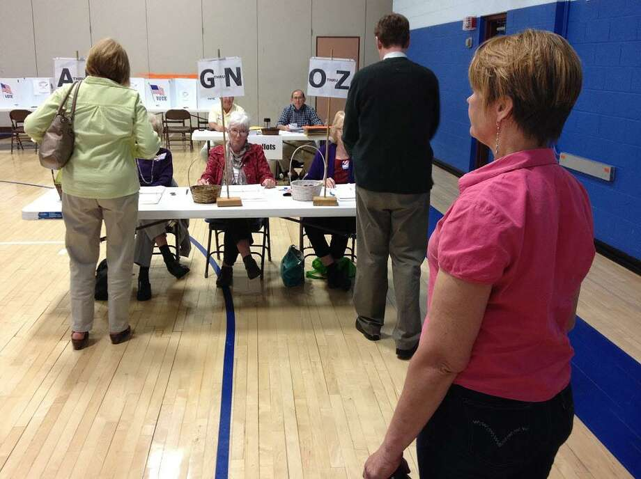 East Hampton voters sign in at East Hampton High School where residents cast their ballot for 2014-15 municipal budget referendum. Photo: File Photo