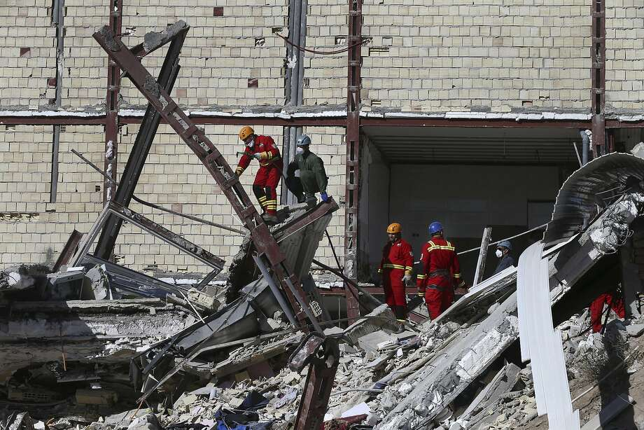 Rescuers search for survivors in Sarpol-e-Zahab in the border region of Iran and Iraq. The town is home to more than half of those killed by the 7.3 magnitude earthquake. Photo: Vahid Salemi, Associated Press