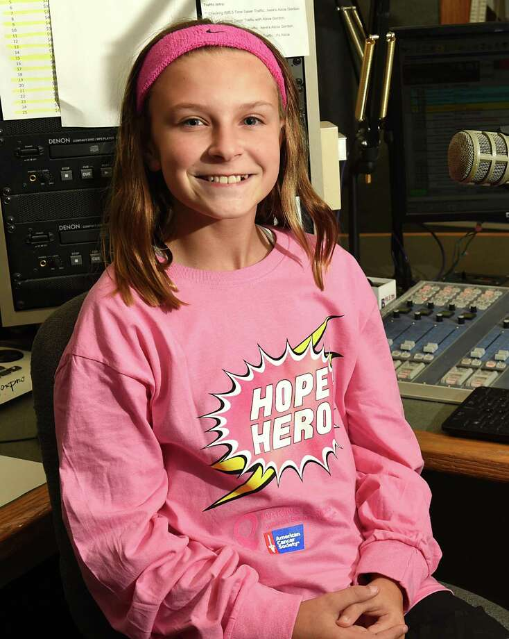 Carli Squires wears pink in a studio at the Albany Broadcasting office on Wednesday, Oct. 11, 2017 in Latham, N.Y. Carli, is an 11-year-old volunteer who helped develop Real Kids Wear Pink along with the American Cancer Society. (Lori Van Buren / Times Union) Photo: Lori Van Buren / 20041793A