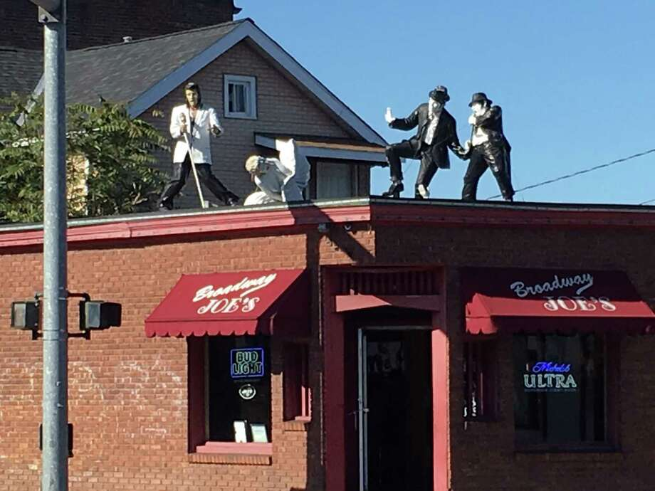 Figures on a rooftop at a Kingston tavern.
