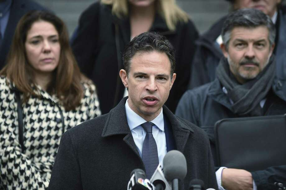 The following slides provides a breakdown of the lawsuit between Sandy Hook families and the Remington Arms Company. Photo: Cloe Poisson /The Courant / The Courant