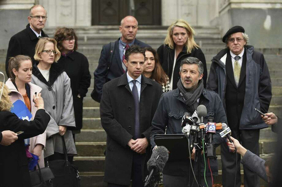 Ian Hockley, father of Dylan Hockley, one of the children killed in the 2012 Sandy Hook shooting, addresses the media after a hearing before the state Supreme Court in Hartford, Conn., Tuesday, Nov. 14, 2017. A survivor and relatives of nine people killed in the shooting are trying to sue Remington Arms, the North Carolina company that made the AR-15-style rifle used to kill 20 first-graders and six educators at Sandy Hook Elementary School. A lower court dismissed the lawsuit. Photo: Cloe Poisson /The Courant / The Courant