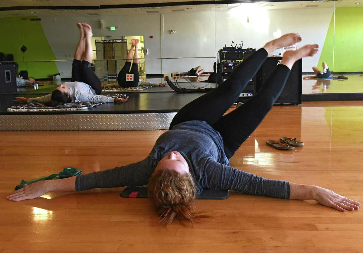 Patricia Washington, left, teaches ptale class at Vent Fitness on Monday, Oct. 2, 2017 in Niskayuna, N.Y. Times Union reporter Leigh Hornbeck is seen taking the class in foreground. (Lori Van Buren / Times Union)