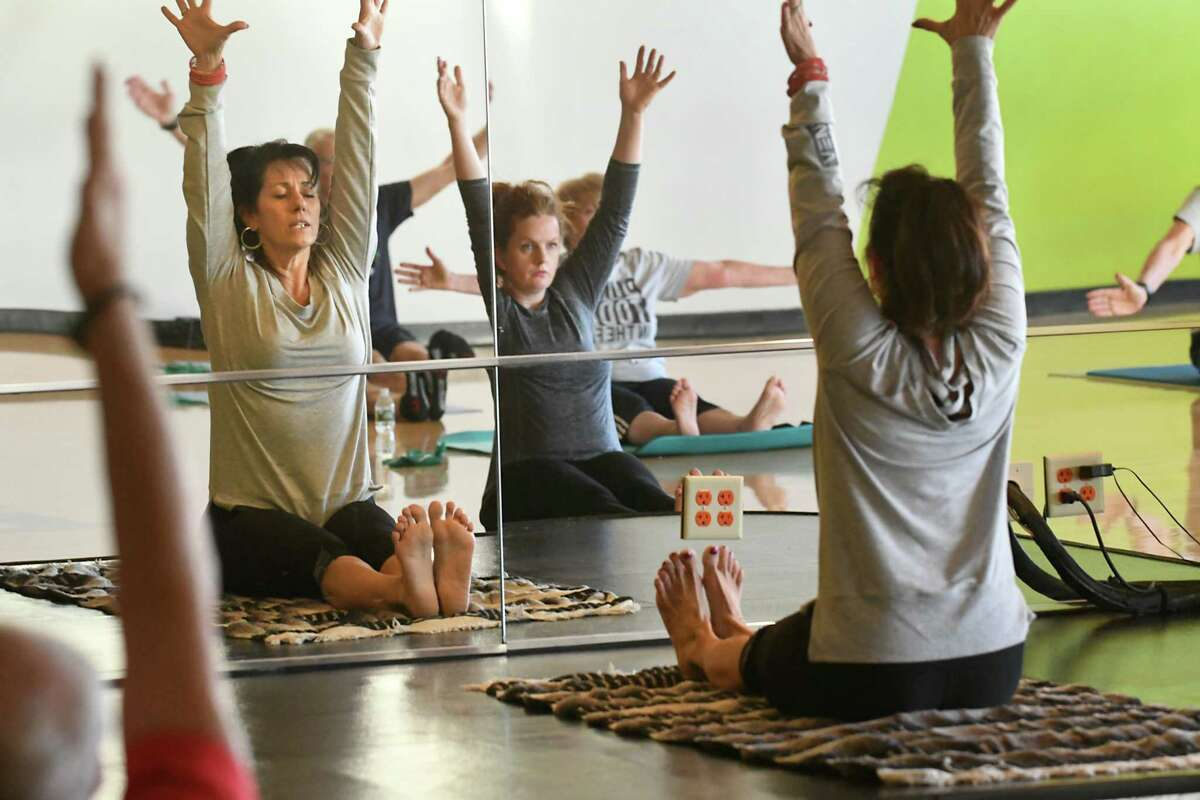 Patricia Washington, left, teaches ptale class at Vent Fitness on Monday, Oct. 2, 2017 in Niskayuna, N.Y. Times Union reporter Leigh Hornbeck is seen taking the class in center. (Lori Van Buren / Times Union)