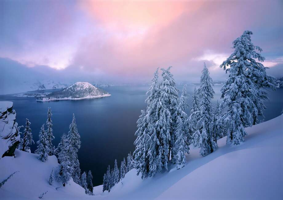 An ethereal winter image captures a radiant sunset at Crater Lake National Park in Oregon. Photo: QT Luong, Courtesy Of QT Luong