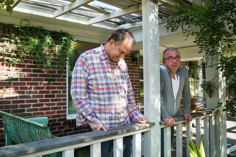 David, left, with Dennis at their house in the Heights. David has been diagnosed with early-onset dementia. Photo: Mark Mulligan, Houston Chronicle / © 2017 Houston Chronicle