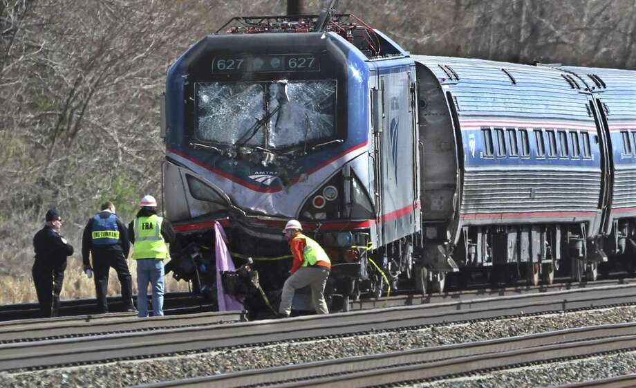 On April 3, 2016, Amtrak investigators inspect the deadly train crash in Chester, Pa. The Amtrak train struck a piece of construction equipment just south of Philadelphia causing a derailment. On Tuesday, federal investigators said Amtrak's safety culture suffered major lapses, including more than two dozen unsafe conditions at a work zone where the train slammed into a maintenance backhoe last year, killing two workers. Photo: Associated Press File Photo / The Philadelphia Inquirer