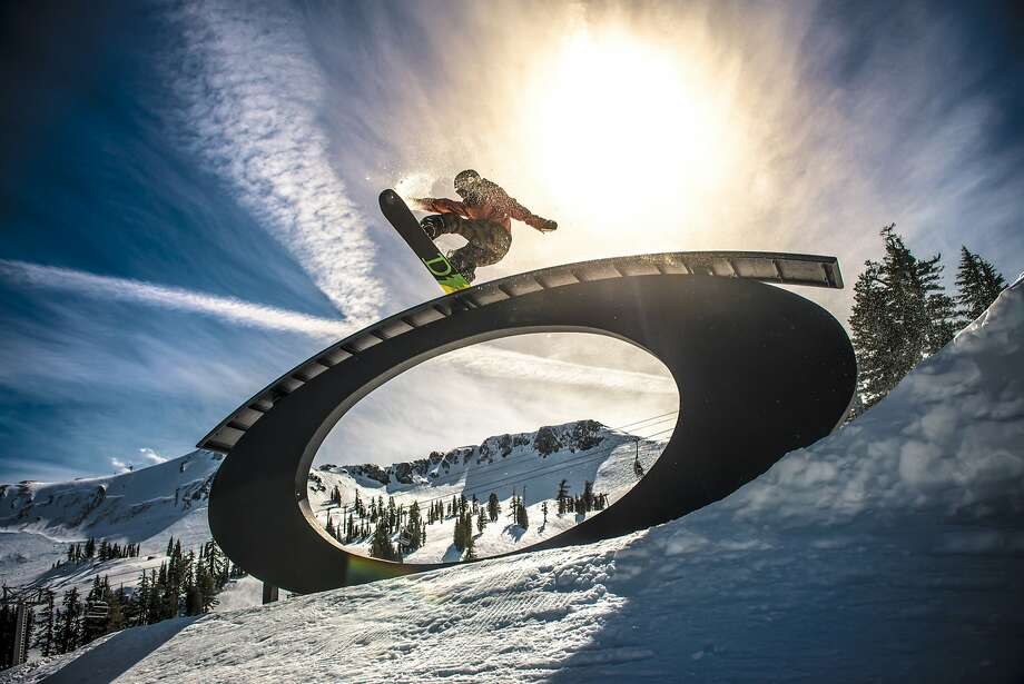A snowboarder catches some air at one of six terrain parks at Squaw Valley Alpine Meadows last winter. The Sierra resort is set to open on Friday as a first major storm of this season moves in. Photo: Matt Palmer, TNS