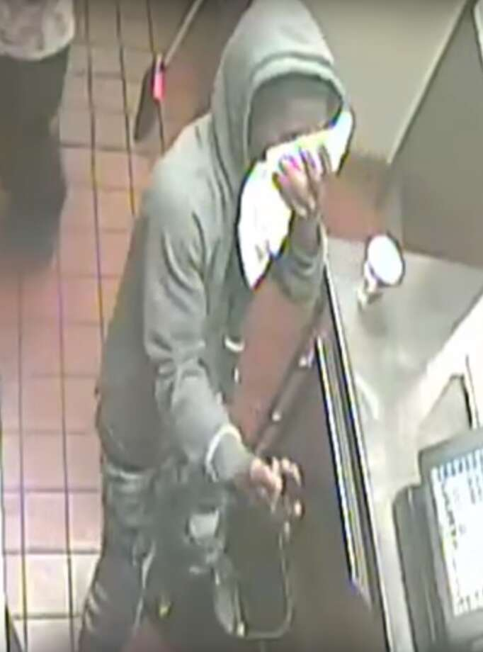Houston police are searching for two armed robbers who burst into a Burger King restaurant near the Medical Center on Sunday, Oct. 29 at about 9:14 p.m. Photo: Houston Police Department