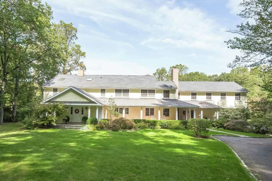 Realty Seven, Inc. listed 14 Nutmeg Lane in Wilton for $1.34 million. The 1974 colonial is situated on 3.39 acres with a private pond. Photo: PlanOmatic / © 2017 PlanOmatic