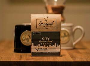 Justin and Aubrey Huestis launched Current Coffee, an online coffee company, in August. The beans are roasted by Chris Coffee Service in Albany.
