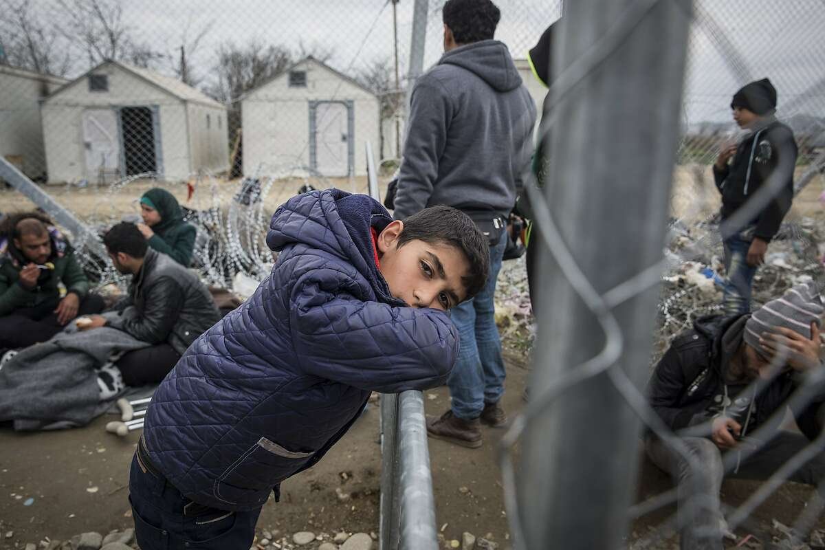 Immigrants on the Greek side of the Greek-Macedonian border wait for the chance to make it to Germany and other Western European counties.