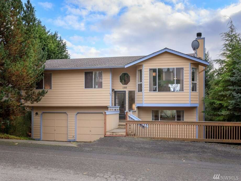South-facing, this three-bedroom home has the outlook and the view to lighten up any winter blues, as well as turn your kitchen into a greenhouse. The insulated windows and natural gas heat source help with utility bills, while the size provides an opportunity to stretch and enjoy. The address is in Silverdale at 1185 N.W. Cloninger Ct., listed for $329,900. See the full listing below.  Photo: Gloria Babb